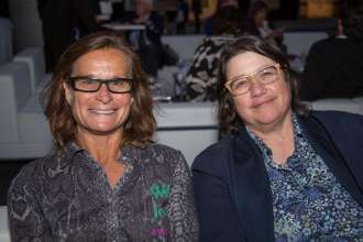 Bonnie Stoll and Catherine Opie at a BMW reception at Paris Photo LA on the evening of April 24, 2014 at Paramount Pictures Studios.