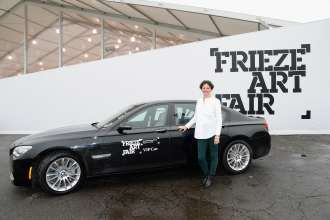 NEW YORK, NY - MAY 08: Cecilia Alemani, curator of Frieze Projects, standing in front of a BMW 7 Series Shuttle Service Car at Frieze Art Fair in Manhattans Randalls Island Park on May 8, 2014. (Photo by Mike Coppola/Getty Images for BMW)