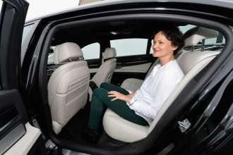 NEW YORK, NY - MAY 08: Cecilia Alemani, curator of Frieze Sounds, sitting in a BMW 7 Series Shuttle Service Car and listening to the works at the Frieze Art Fair in Manhattans Randalls Island Park on May 8, 2014. (Photo by Mike Coppola/Getty Images for BMW)