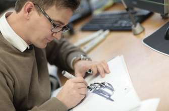 BMW Exterior designer Tommy Forsgren while sketching the new BMW X6 (06/14).