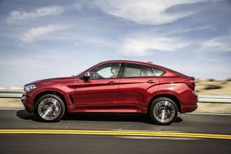 The new BMW X6 M50d in Flamenco Red (06/2014).