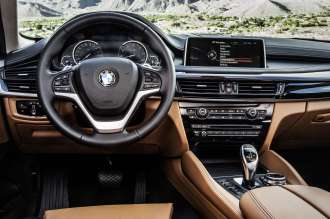 The new BMW X6 - Bicolour Leather Nappa with extended contents Cognac/Black - Interior design Pure Extravagance Cognac (06/2014).