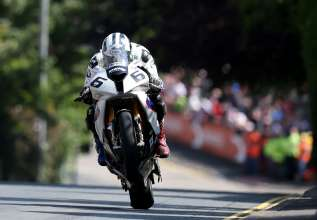 Isle of Man TT(GBR). 31st May 2014. Team BMW Motorrad/Hawk Racing Rider Michael Dunlop (GBR) racing the BMW S 1000 RR. This image is copyright free for editorial use © BMW AG