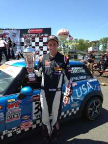 Tyler Palmer shows off his trophy from Race 2 of this weekend's Pirelli World Challenge race at New Jersey Motorsports Park. (06/2014)