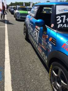 A number of MINIs are lined up at the starting line of this weekend's Pirelli World Challenge race at New Jersey Motorsports Park. (06/2014)