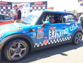 Tyler Palmer poses for the camera while tucked into the seat of his 2012 MINI Cooper Hardtop owned by MINI of Charleston Racing. (06/2014)