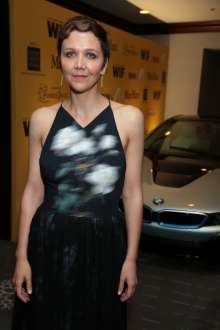 Maggie Gyllenhaal with the BMW i8, a plug-in hybrid, high-performance electric vehicle, during the 2014 Crystal + Lucy Awards® fundraising dinner, in support of Women in Film, Los Angeles held on Wednesday, June 11, 2014 at the Hyatt Regency Century Plaza in Century City. BMW i is the BMW Group's forward-looking and sustainable brand dedicated to solving many of the mobility challenges faced by the world's most densely populated cities and  served as a premiere sponsor of the awards.