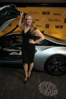 Joely Fisher with the BMW i8, a plug-in hybrid, high-performance electric vehicle, during the 2014 Crystal + Lucy Awards® fundraising dinner, in support of Women in Film, Los Angeles held on Wednesday, June 11, 2014 at the Hyatt Regency Century Plaza in Century City. BMW i is the BMW Group's forward-looking and sustainable brand dedicated to solving many of the mobility challenges faced by the world's most densely populated cities and  served as a premiere sponsor of the awards.