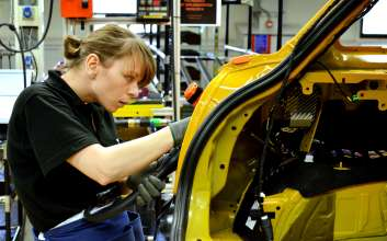 An associate working on the new 5-door MINI in Plant Oxford's assembly hall.