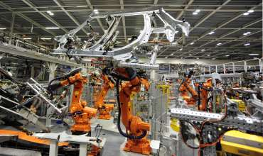 Robots working on the side frame of the new MINI 5-door in Plant Oxford's bodyshop.