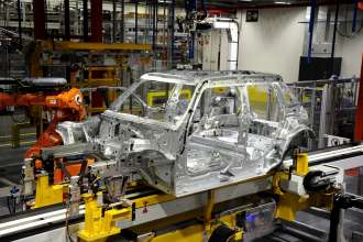 The bodyshell of the new 5-door MINI as it goes through Plant Oxford's bodyshop.