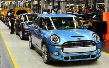 An Electric Blue MINI 5-door comes off the assembly line.