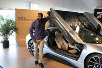 Kyle Arrington of the New England Patriots with the BMW i8 plug-in hybrid vehicle during the first stop of BMW's Ultimate Driving Experience at Gillette Stadium in Boston, MA on Wednesday, June 18, 2014. The Ultimate Driving Experience is a nationwide tour that features over 80 BMW vehicles and offers dynamic behind-the-wheel driving programs through eight events in seven markets for a total of 74 event days. (Photo Credit: Automotive Rhythms)