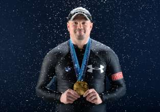 WEST HOLLYWOOD, CA - APRIL 26:  Bobsledder Steven Holcomb poses for a portrait with his gold medal during the USOC Portrait Shoot on April 26, 2013 in West Hollywood, California.  (Photo by Harry How/Getty Images)