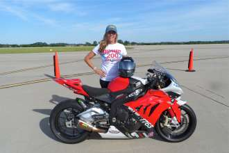 Thompson set her 6th land speed racing record at the Ohio Mile with a blistering speed of more than 208 mph on her BMW S 1000 RR, becoming the newest female member of the prestigious ECTA 200 MPH Club.  (06/2014)