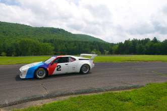The BMW M1 IMSA Group 4 race car appears at Legends of the Autobahn, 2014.