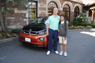 PGA TOUR Player Hunter Mahan was presented with his all-electric BMW i3 on Tuesday, August 19, 2014 at the Barclays Tournament in Paramus, NJ.  In addition to receiving the BMW i3, Mahan met Melyzjah Smith, the 2013 BMW Hole-in-One Scholar, who was awarded a full, four-year tuition and housing grant as a result of Mahan's hole-in-one during the 2013 BMW Championship at Conway Farms Golf Club in Lake Forest, IL. (08/2014)