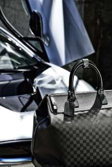 "The tailor-made Louis Vuitton luggage set for the BMW i8 made from carbon fibre: small ""Weekender PM i8"". (08/2014)"