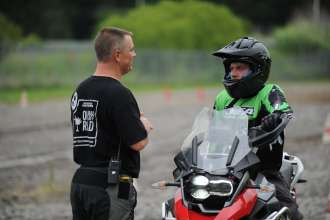 Ross McKinney, a BMW Performance Center instructor, works with GS Trophy Team USA member Ben Profitt during the two-day training session. (08/2014)