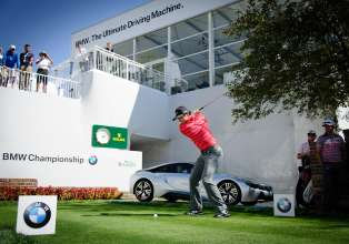 2012 BMW Championship winner Rory McIlroy attempted to recreate Arnold Palmer's historic drive from the 1960 U.S. Open at Cherry Hills Country Club's 1st tee to kick-off the 2014 BMW Championship. Using a replica Persimmon driver with a steel shaft and wood head from the same era, McIlroy came closest to the green with a 300-yard drive. BMW made an additional $10,000 donation to the Evans Scholars Foundation, which grants full college scholarships to young deserving caddies of financial need. Since BMW became title sponsor in 2007, the tournament has raised more than $16 million for the Evans Scholars Foundation. (09/2014)
