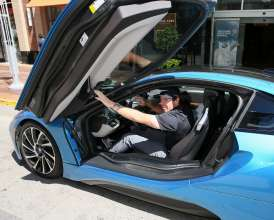 2012 BMW Championship winner Rory McIlroy hops in the revolutionary plug-in hybrid BMW i8 during the 2014 BMW Championship in Cherry Hills Village, Colo.  Each of the top 70 players on the PGA TOUR at the BMW Championship received a BMW to drive for the week. McIlroy stood out in the BMW i8 and the other players were given a BMW 7 Series, the flagship sedan, to drive for the week. (09/2014)