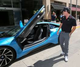 2012 BMW Championship winner Rory McIlroy with the revolutionary plug-in hybrid BMW i8 during the 2014 BMW Championship in Cherry Hills Village, Colo.  Each of the top 70 players on the PGA TOUR at the BMW Championship received a BMW to drive for the week. McIlroy stood out in the BMW i8 and the other players were given a BMW 7 Series, the flagship sedan, to drive for the week. (09/2014)