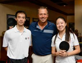 PGA TOUR Player Freddie Jacobson poses with Team USA Table Tennis players Timothy Wang and Lily Zhang before he challenges them to a game in the Cherry Hills Country Club Men's Locker Room during the 2014 BMW Championship in Cherry Hills Village, Colo. Lily Zhang is the 2012 U.S. National Champion in Women's Singles and Timothy Wang is the 2013 U.S. National Champion in Men's Singles, Doubles and Mixed Doubles.  (09/2014)