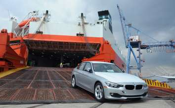 BALTIMORE, MD - SEPTEMBER 18:  BMW vehicles coming off of the Wallenius Wilhemsen Logistics vessel during the official opening of BMW's newest Vehicle Distribution Center on September 18, 2014 in Baltimore, Maryland.  (Photo by Larry French/Getty Images for BMW)