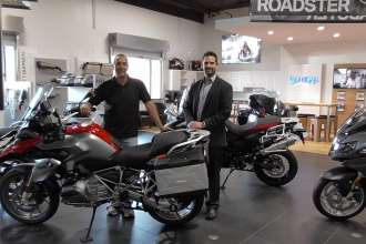 Carlos Gonzalez (left) and Kenny Martin (right), co-owners of BMW Motorcycles of Denton, welcome visitors to their new dealer showroom. (11/2014)