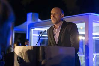 Marc Spiegler, Director of Art Basel speaking at a BMW Reception celebrating the BMW Art Journey, a new art project supporting emerging artists in cooperation with Art Basel, at the Miami Beach Botanical Gardens in Miami, FL on December 3, 2014.