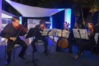 New World Symphony and Debussy's String Quartet performing at a BMW Reception celebrating the BMW Art Journey, a new art project supporting emerging artists in cooperation with Art Basel, at the Miami Beach Botanical Gardens in Miami, FL on December 3, 2014.