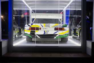 BMW 320i Art Car by Roy Lichtenstein, 1977 unveiled at a BMW Reception celebrating the BMW Art Journey, a new art project supporting emerging artists in cooperation with Art Basel, at the Miami Beach Botanical Gardens in Miami, FL on December 3, 2014.