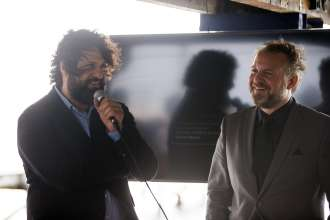Juan Gaítan, director of the last Berlin Biennial and BMW Art Journey jury member speaking at a BMW event celebrating the BMW Art Journey, a new art project supporting emerging artists in cooperation with Art Basel, at Stiltsville in Miami, FL on December 4, 2014.