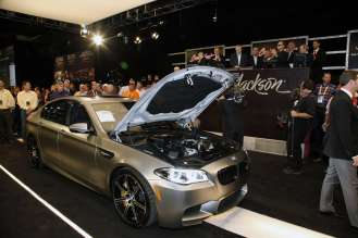 The 30th Anniversary BMW M5 up close with open hood displaying the 600 horsepower BMW M engine. (01/2015) Photos Courtesy Barrett-Jackson