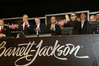 Cheering on the auction are BMW of North America CEO Ludwig Willisch, Barrett-Jackson president Craig Jackson and famed Indy 500 winner Bobby Rahal. (01/2015) Photos Courtesy Barrett-Jackson