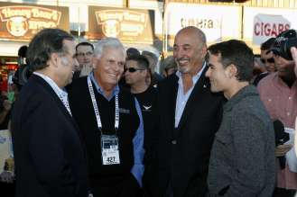 Congratulating winning bidder Rick Hendrick are BMW of North America CEO, Ludwig Willisch, Indy 500 winner and BMW Team RLL principal Bobby Rahal, and famed NASCAR driver Jeff Gordon. (01/2015) Photos Courtesy Barrett-Jackson.