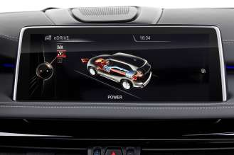 The new BMW X5 xDrive40e. Display: SAVE Battery (charging) (03/2015).