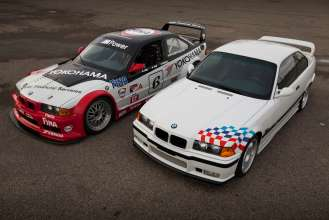 The No. 6 BMW Team PTG M3 race car poses with its street car counterpart, the 1995 BMW M3 Lightweight. (04/2015)