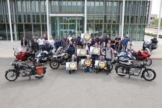 In a show of support for Dr. Hans-Henning Buetzow's 50,000-mile Ride of Smiles charity motorcycle journey, employees of BMW of North America, L.L.C. brought their motorcycles and their smiles to work on Friday, May 15, 2015. (05/2015)