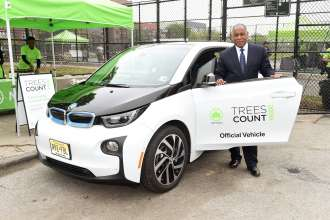 NYC Parks Commissioner Mitchell J. Silver with one of the 20 BMW i3 electric vehicles donated to NYC Parks in support of the TreesCount! census during a press conference at Julio Carballo Fields on Tuesday, May 19, 2015 in the Bronx Borough of New York. (Photo by Scott Gries/Invision for BMW of North America/AP Images)