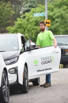 With one of 20 donated BMW i3 electric vehicles, a TreesCount! 2015 volunteer prepares to map trees following an NYC Parks press conference at Julio Carballo Fields on Tuesday, May 19, 2015 in the Bronx Borough of New York. (Photo by Scott Gries/Invision for BMW of North America/AP Images)