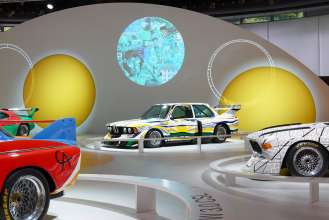 The BMW Art Car by Roy Lichtenstein, framed by the BMW Art Cars by Andy Warhol, Alexander Calder and Frank Stella, in the special BMW Art Car exhibition during the Concorso d'Eleganza weekend. (c) BMW AG Photo: Christian Kain (05/2015)