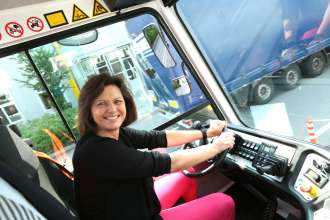 Ilse Aigner, Bavaria's Minister for Economic Affairs and Media, Energy and Technology, at the wheel of the electric truck (07/2015)