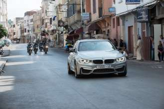 The new BMW M3 chased by several BMW S 1000 RR in