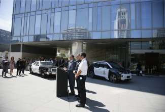Los Angeles Mayor Eric Garcetti, with Los Angeles Chief of Police Charlie Beck and Fire Chief of the Los Angeles Fire Department Ralph Terrazas, announces year-long fleet test of the BMW i3 EV by LAPD as part of the city of Los Angeles' green vehicle initiative.