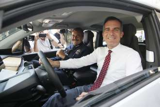 Los Angeles Mayor Eric Garcetti and Los Angeles Police Chief Charlie Beck at announcement of year-long test of  BMW i3 by LAPD