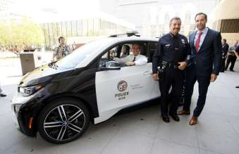 Los Angeles Mayor Eric Garcetti and Los Angeles Police Chief Charlie Beck with Petter Witt, Vice-president-Western Region, BMW of North America at announcement of year-long test of  BMW i3 by LAPD.