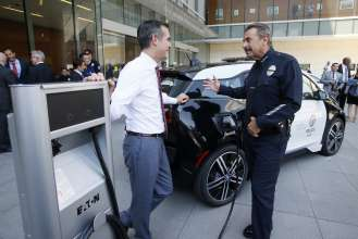 Los Angeles Mayor Eric Garcetti and Los Angeles Police Chief Charlie Beck at announcement of year-long test of  BMW i3 by LAPD.