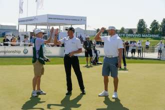 On Wednesday, September 16, 2015 during the 2015 BMW Championship at Conway Farms Golf Club in Lake Forest, IL, former Chicago Bears linebacker Brian Urlacher and PGA TOUR player Henrik Stenson high fives Evans Scholar Caddie Jordan Pounder after competing in a race to the hole, each using a miniature high-performance remote controlled BMW i8.   Jordan's successful attempt resulted in a $10,000 donation from BMW to the Evans Scholars Foundation on his behalf.