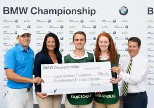 On Thursday, September 17, 2015 at the 2015 BMW Championship Trudy Hardy, Vice President of Marketing, BMW of North America presented PGA TOUR Player Jordan Spieth with a check from BMW representing another BMW Hole-In-One Scholarship, a full, four year Evans Scholarship worth $100,000. Later this year, BMW and the Western Golf Association (WGA), sponsor of the Evans Scholars Foundation, will jointly select and award the 2015 BMW Hole-in-One Scholarship in Spieth's name to a student caddie who will attend college next fall. Tyler Mount and Rose McBride, Evans Scholars at Northwestern University, and WGA President and CEO John Kaczkowski accepted the donation on behalf of the Evans Scholars Foundation.  Spieth aced the 2nd hole, his 11th hole of the day, with a 7-iron, from 184 yards.
